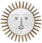 Piero Fornasetti, miroir « Viso » (visage), vers 1950 Verre biseauté à la main dans un cadre de rayons de laiton. Diamètre 50 cm © Courtesy Fornasetti